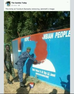 Soldiers tear down exiled presidents Jammeh's poster from Barrack walls