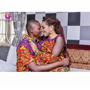 Man cuddles and grabs fiancee's backside in playful pre-wedding photos