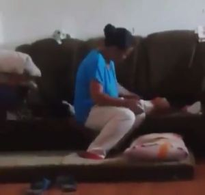 Outrage as nanny is caught on CCTV abusing three-month-old baby (Video)