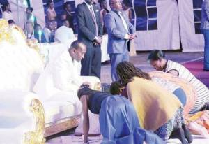 See photos of church members kissing their Pastor's feet