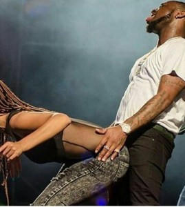 Check Out Davido's Face As A Lady Rocks Him On Stage (Photos)