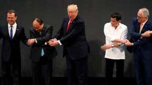 Donald Trump gets confused by the group handshake at Asean (Video)