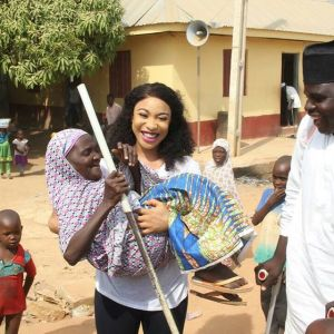 Tonto Dikeh Carries A Crippled Woman As She Visits The Disabled in Abuja (Photos)