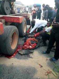 Truck Driver Crushes His Conductor To Death In Delta State (Graphic Photos)