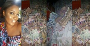 Nigerian lady shows off money she saved in her Piggy Bank in 4 months (Photos)