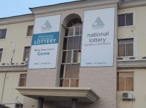 Winner collects N20million National Lottery win in Abuja