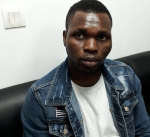 Nigerian Man Arrested While Trying To Use An Ivorian's Passport To Travel In India -Photos