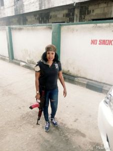 Check out this female police officer posing with her gun (Photos)