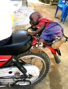 LOL: See As This Kid Is Tied To A Motorcycle And Forcefully Taken To School (Photo)