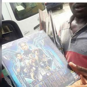 ", See This Man Already Hawking ""Black Panther"" Movie In Lagos Traffic (Photo), Effiezy - Top Nigerian News & Entertainment Website"