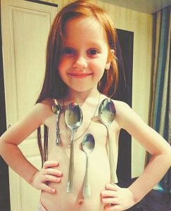 AMAZING: Check out this little girl that has a magnetic body, her body can attract metal objects (Photos)