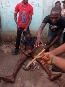 See This Thief Who Makes His Snake Swallow His Loot Caught In Benin, Edo State. (Photos)