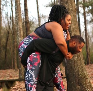Check out this viral photo of a man carrying his plus-sized wife in pains (Photo)