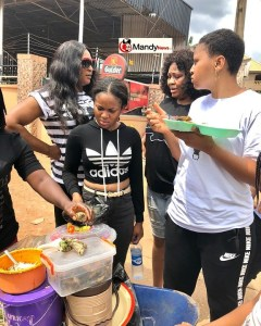 See Regina Daniels Eating Abacha On The Road (photos)