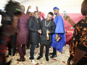 Check out this money rain in a child's dedication in Owerri (Photos)