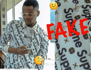 Kiss Daniel Busted For Wearing & Posing With A Fake Louis Vuitton Shirt (Photos)