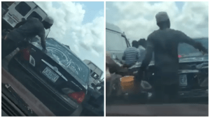 HUSTLE!! Watch How These Guys Washed A Car While In Lagos Traffic (Video)