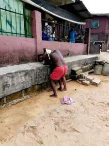 Check Out Viral Photos Of An Half-Naked Woman Fighting With A Younger Lady In Delta State (Photos)
