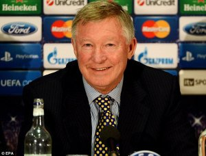 "Sir Alex Ferguson ""out of coma, talking to family"""