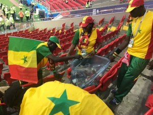 , #WorldCup: Senegal Fans Clean Up The Stadium After Their Victory Over Poland, Effiezy - Top Nigerian News & Entertainment Website