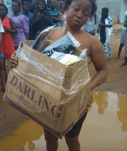 Outrage as woman is stripped, paraded, and made to roll in muddied water for stealing hair extensions (Photos)
