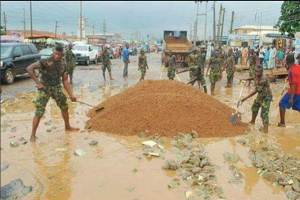 Check Out Soldiers Fixing A Damaged Road (Photo)