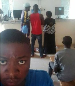 Check Out A Nursing Mother Playing Bet9ja in Lagos (Photo)