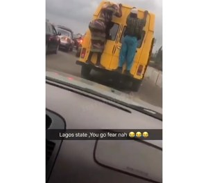 Check Out This Couple Perching On The Bumper Of A Danfo Bus In Lagos. (Video)