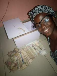 Nigerian Lady Saved N105,000 In 2 Months From Her Piggy Bank (Photos)