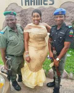 2 Nigerian Armed Police Men All Smile While Posing With Heavily Endowed Lady (Photo)