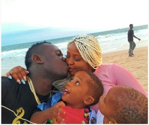 Duncan Mighty's Kids Looking At Him As He Kisses Wife In Lovely Photo