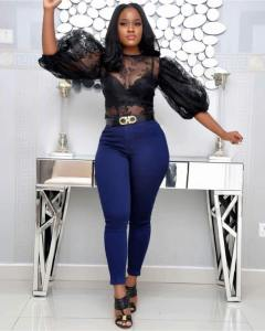 Cee-C Stuns In Figure-Hugging Jeans And See-Through Top