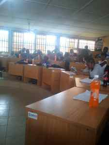 University Of Calabar Lecturer Gives Soft-Drink To His Students During Lecture