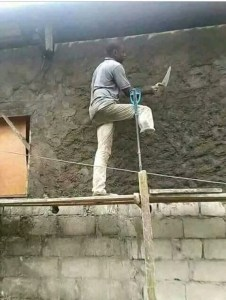 TOUCHING!! Photo Of A Disabled Man Plastering A House (Photo)