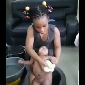 VIDEO: Check out this small girl bathing a baby (Video)