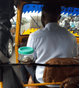 """Check out this """"Corporate keke driver"""" who has sweets and his business card in his tricycle for passengers (photos)"""