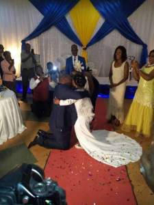 WOW!!! Zambian Man Weds His Dwarf Wife, Kneels Down To Hug And Kiss Her (Photos)