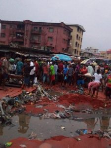 Lady Killed By Heavy Rainfall In Onitsha, Anambra State. (Disturbing Photos)