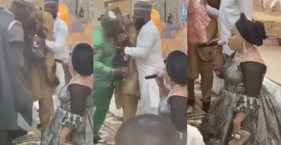 Nigerian man cries as his wife kneels and praises him (Video)