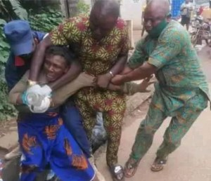 Mad Woman Fight Her Helpers As They Try To Take Her And Her Son Off Street.