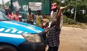 Man kneels in front of FRSC van pleading for his license to be released (Video)