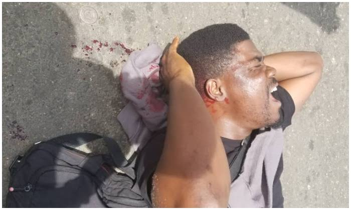Policemen brutalise Punch journalist at Lagos October 1 protest (graphic photo)