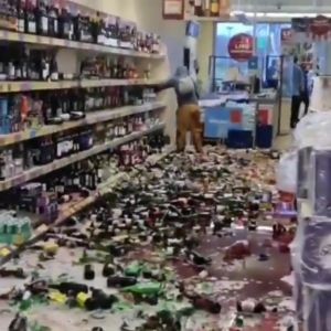 Woman shatters hundreds of alcohol bottles in Aldi supermarket in the UK (Video)