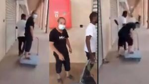 Locals react to Chinese national being pulled on a trolley by his Zambian employee (video)