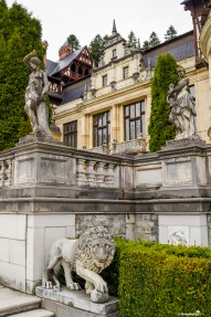 Lions and statues in the courtyard of the Peles Castle, Sinaia