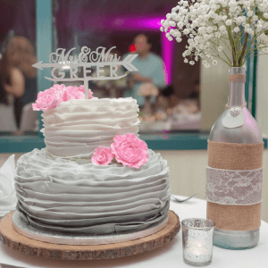 Save money on your wedding cake by buying a small one for the cake cutting and another for the guests. You can also get assorted sweets instead of a sheet cake.