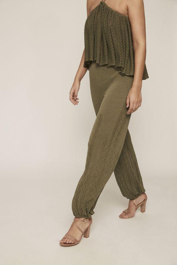 Green knit jogger pants. Featuring see-through motifs and an elastic waist