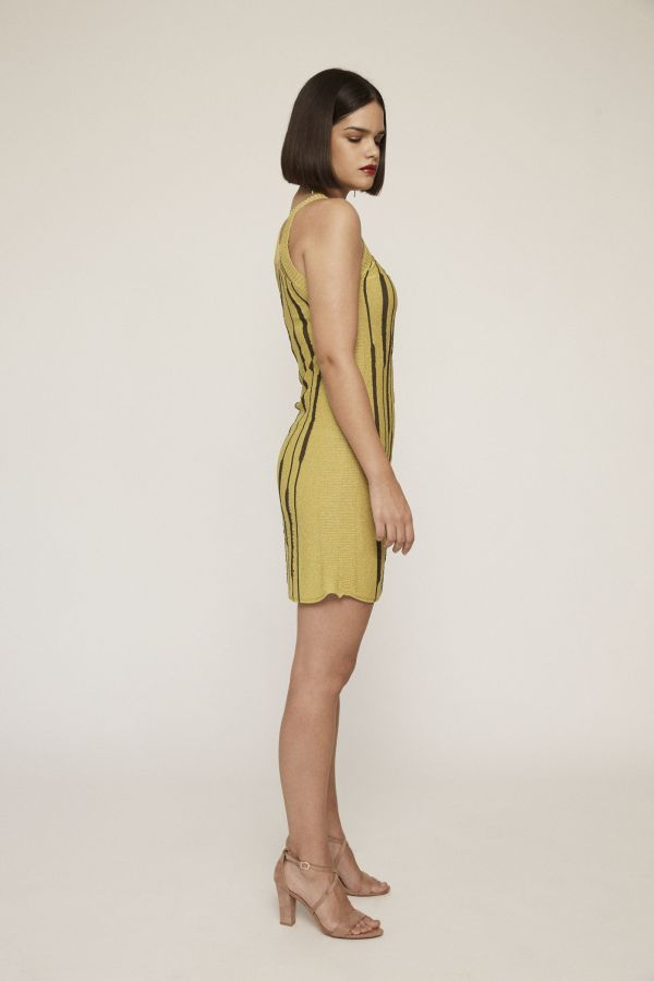 Short lime knit dress with textured straps and trims and contrasting see-through motifs.