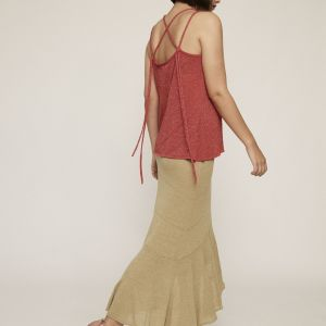 Shimmery crimson knit top. Featuring V neckline, thin crossed double straps and strings.