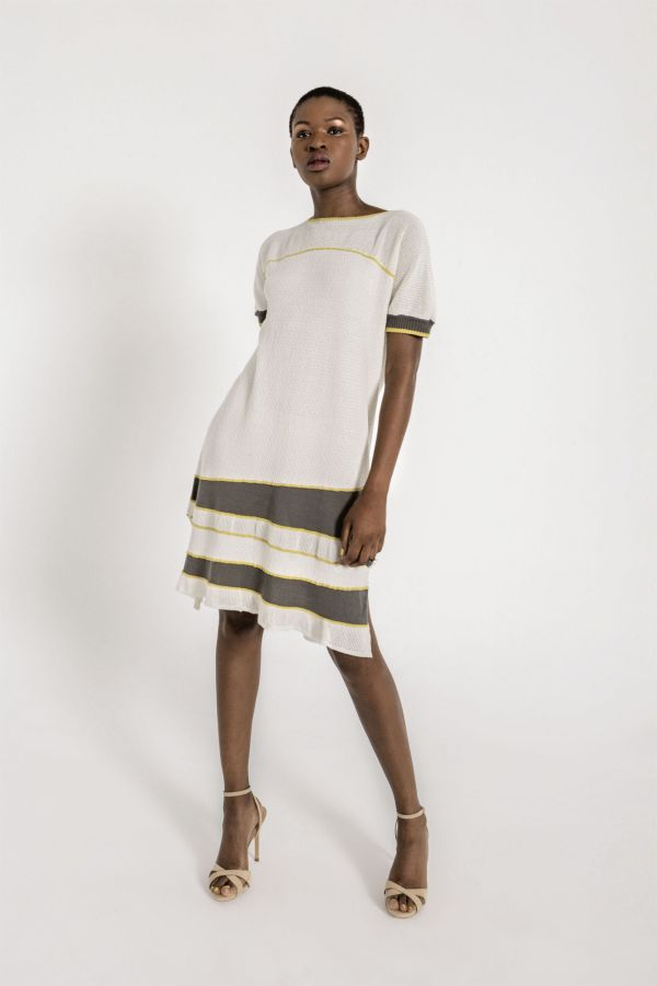 Delicate and empowering. Short sleeve A shape textured knit dress, with round neckline and contrasting details